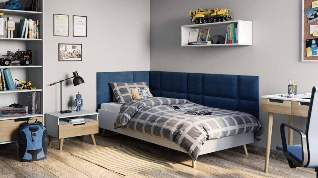 Niebieskie panele tapicerowane marki Vilo za łóżkiem