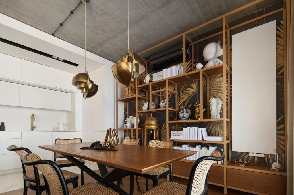 53-metrowy apartament dla młodego małżeństwa - stylowa zabudowa meblowa w salonie
