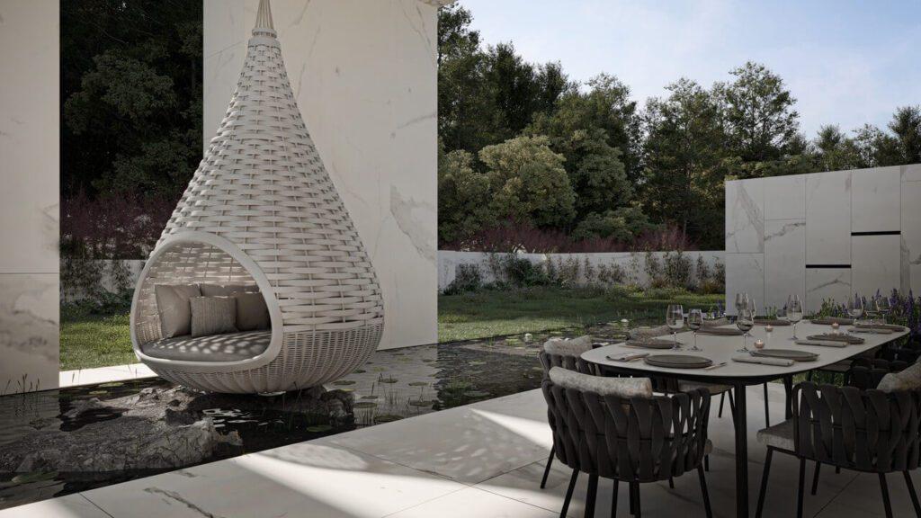 Fotel nad sadzawką w ogrodzie w projekcie Marcina Tomaszewskiego z pracowni REFORM