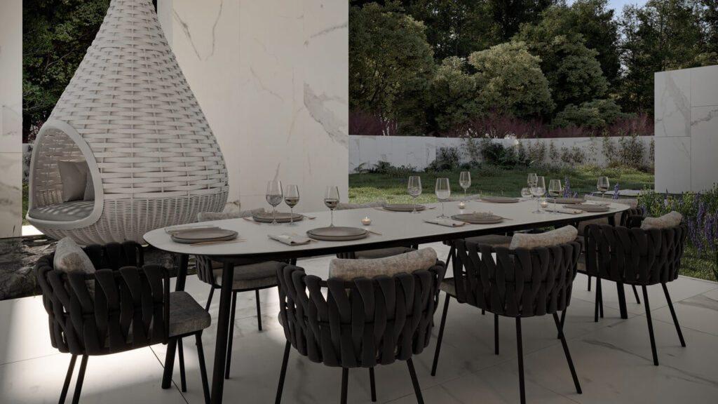 Zestaw mebli ogrodowych w ogrodzie w projekcie Marcina Tomaszewskiego z pracowni REFORM - dom RE: BIANCO HOUSE