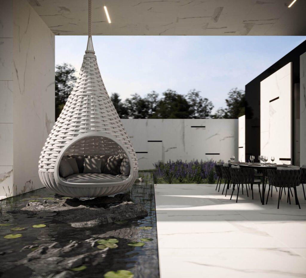 Fotel nad sadzawką w ogrodzie w projekcie Marcina Tomaszewskiego z pracowni REFORM - dom RE: BIANCO HOUSE
