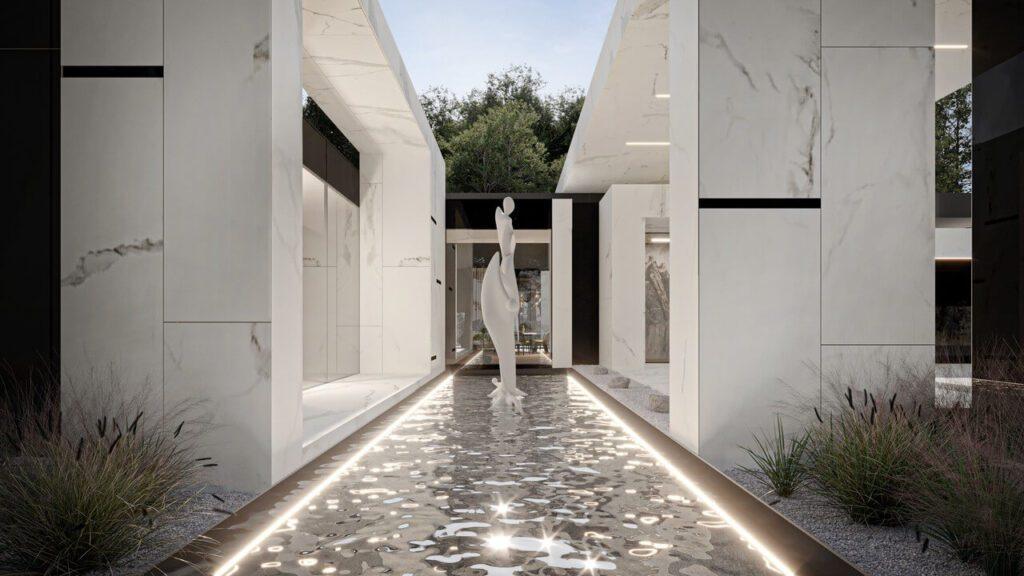 Rzeźba w strefie wejścia w projekcie Marcina Tomaszewskiego z pracowni REFORM Architekt