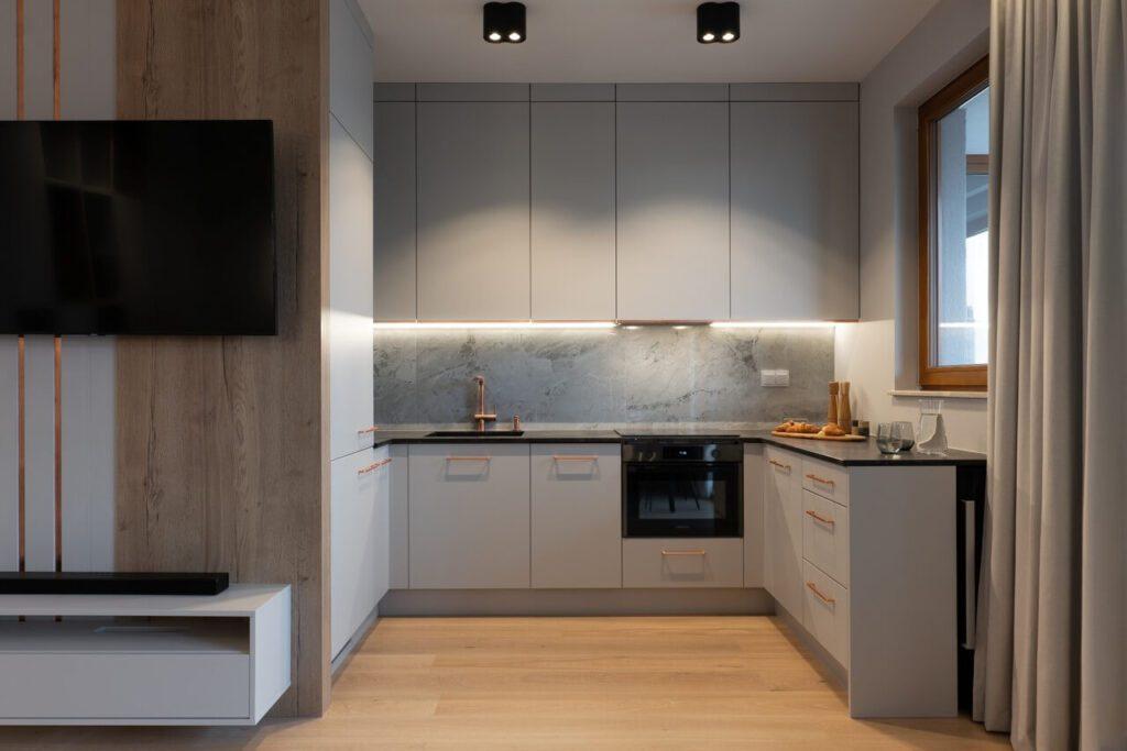Szare meble kuchenne w projekcie niewielkiego mieszkania